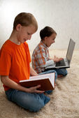 Two children with books and laptop — Stock Photo
