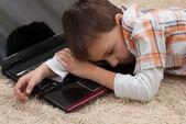 Baby sleeps on a laptop — Stock Photo