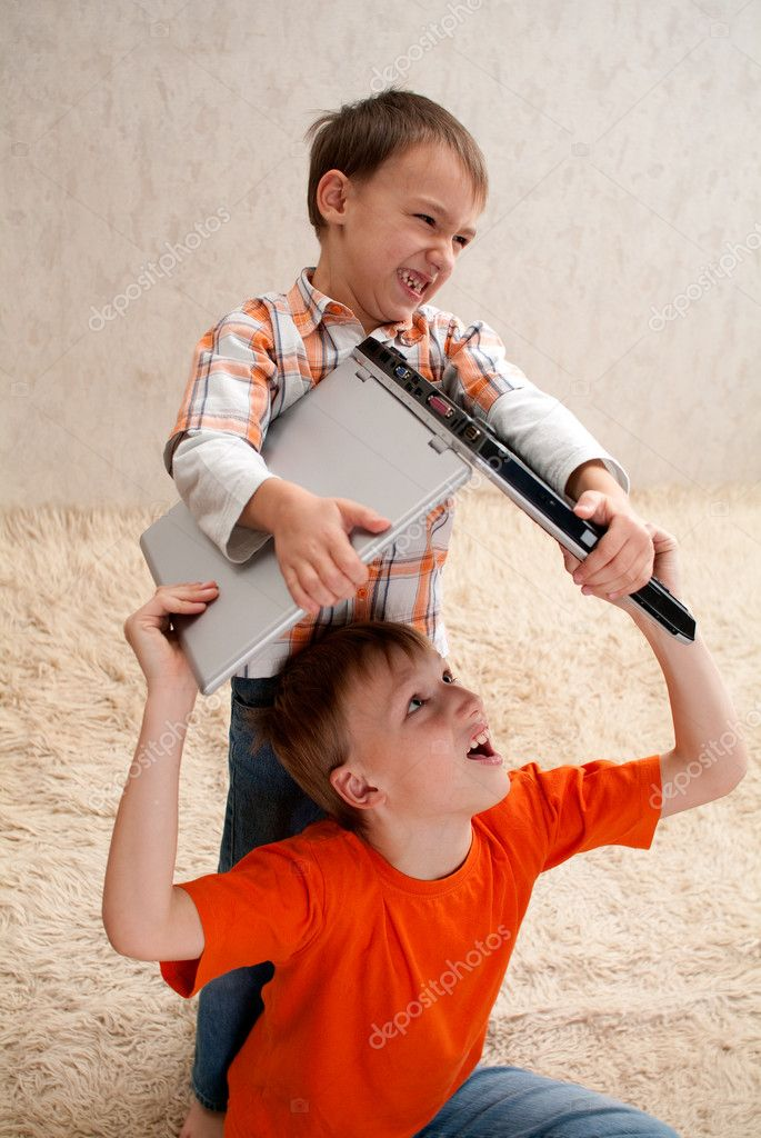 The younger brother takes his elder brother laptop — Stock Photo #1127892
