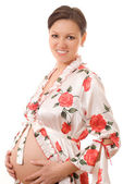 Pregnant woman standing on a white — Stock Photo