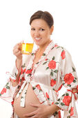 Pregnant woman is drinking tea — Stock Photo
