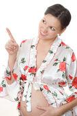 Schwangere frau zeigt sich finger — Stockfoto
