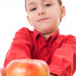 Boy in a red shirt holding an apple — Stock Photo