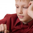 Boy thinks on the calculator — Foto Stock