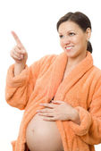 Pregnant act of women standing — Stockfoto