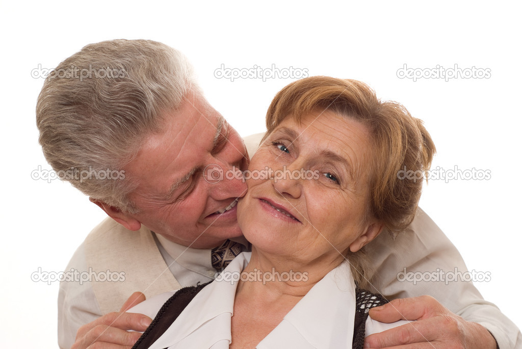Happy old couple standing and smiling — Stock Photo #2204872