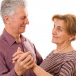Royalty-Free Stock Photo: Old couple dancing on a white background