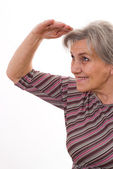 Senior woman shielding her eyes — Stock Photo