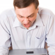 Young man blamed for a laptop - Stock Photo