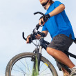 Stock Photo: Young bicyclist in helmet