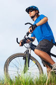 Young bicyclist in helmet — Stockfoto