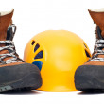 Climbing orange helmet and boots — Stock Photo #1029650