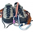 Carabiners, ropes and climbing shoes - Stock Photo