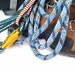 Climbing And Hiking Gear - Carabiners, Rope And Boots - Stock Photo