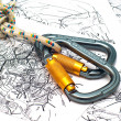 Two climbing carabiners on a map — Stock Photo