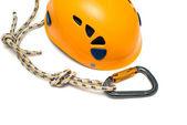 Carabiner and orange helmet — Stock Photo