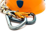 Climbing carabiner and helmet — Stock Photo