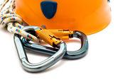 Climbing carabiner and helmet — Stock Photo