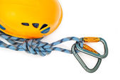 Carabiners, orange helmet and rope — Stock Photo