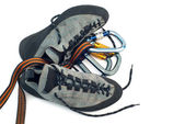 Carabiners and climbing shoes — Stock Photo