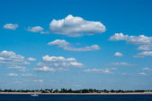Sky with clouds over the river — Stock Photo