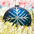Royalty-Free Stock Photo: Blue christmas ball on the shiny decorat