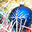 Stock Photo: Blue christmas ball on shiny decorat