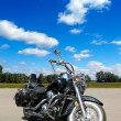 Motocycle on a road on a blue sky backgr - Stockfoto