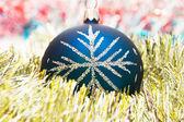 Blue christmas ball on the shiny decorat — Stock Photo
