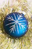Blue christmas ball on the shiny decorat — Stock Photo
