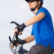 Young bicyclist in helmet — Stock Photo