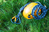 Carabiners, helmet and rope — Stock Photo