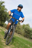 Young bicyclist in a blue helmet — Stock Photo