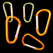 Set of isolated on black carabiners — Stock Photo