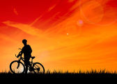 Silhouette of the biker — Stock Photo