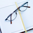 Glasses on the notebook — Stock Photo