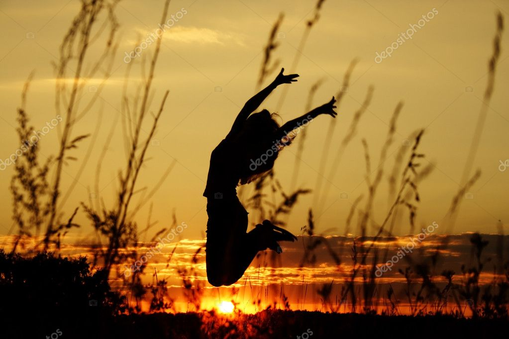 Dark silhouette of the jumping girl on a background of a decline — Stock Photo #1011971