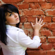 Woman near the brick wall — Stock Photo #1027349