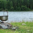 Kettle at the river — Stock Photo