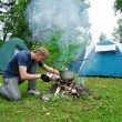 Guy plants a fire — Stock Photo #1030273
