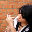 Woman with a cigarette — Stock Photo