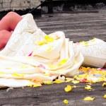 Woman among petals of roses — Stock Photo #1033761