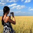 Royalty-Free Stock Photo: Girl photographes the nature