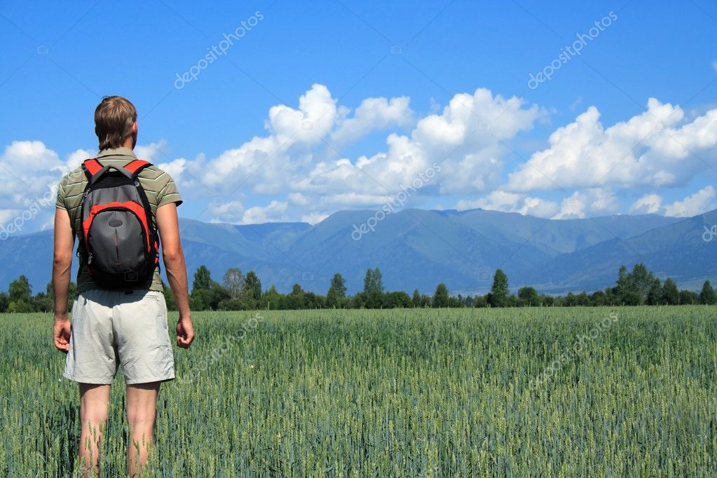 One person costs in a floor and looks at mountains — Stock Photo #1030319