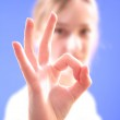 The girl shows gesture of approval to something — Stock Photo #1042628