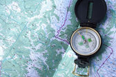 Compass on the map — Stock Photo