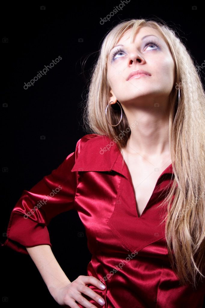 Charming girl in red on a black background — Stock Photo #1053087