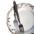 Stock Photo: Plate and fork