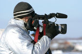 Journalist with a videocamera — Stock Photo