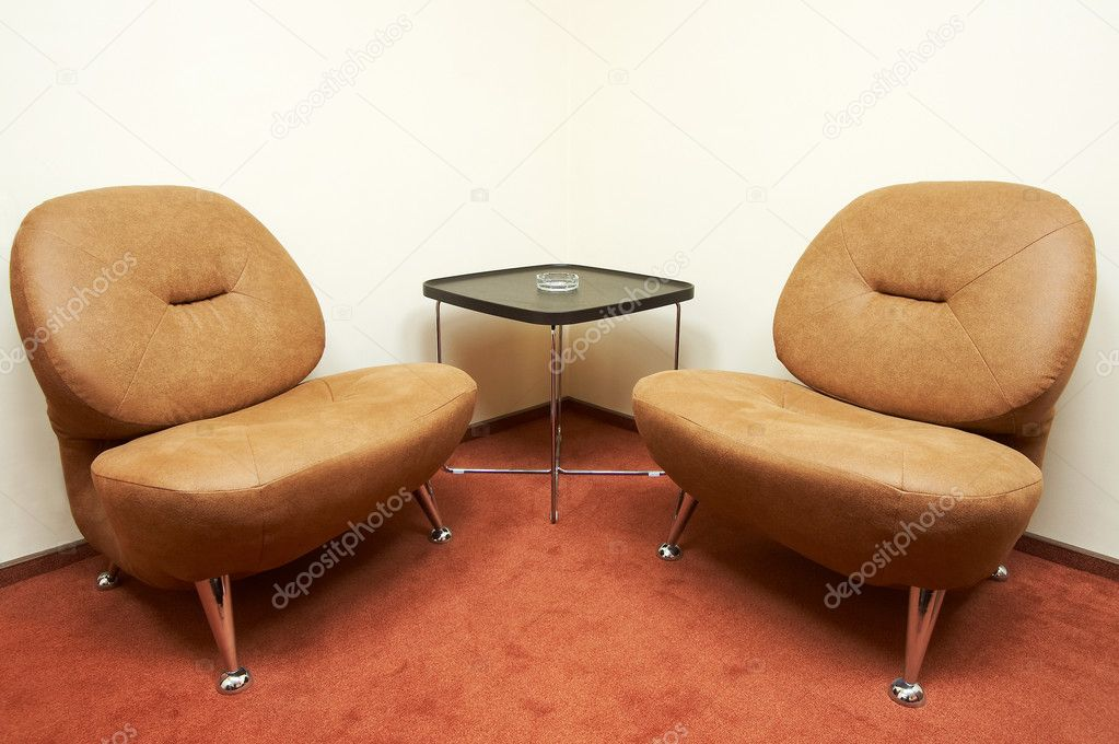 Two leather armchairs and ashtray on a table  Zdjcie stockowe #1034034
